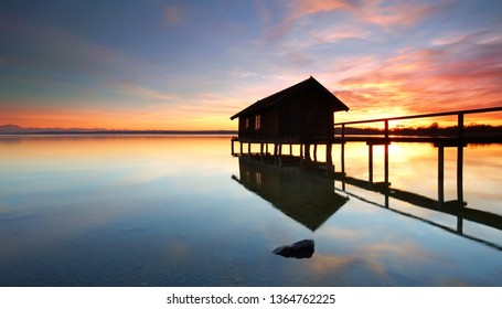 boat house with magic light at lake