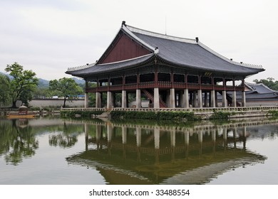 Boat House reflecting in lake at Gyeonbokgung Palace in Seoul, South Korea