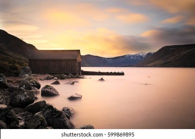 Boat house at sunset on Loch Muick, Ballater, Scotland