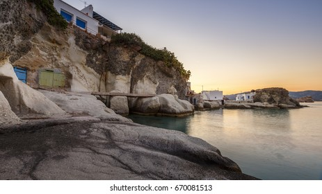 Boat houses in fishing village of Goupa on Kimolos island in Greece.