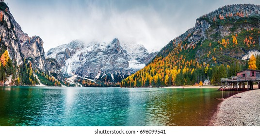 Boat hut on Braies Lake with Seekofel mount on background. Colorful autumn panorama of Italian Alps, Naturpark Fanes-Sennes-Prags, Dolomite, Italy, Europe. Traveling concept background.