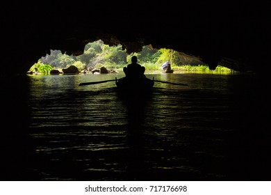 A boat inside a flooded cave on the Ngo Dong River, near Tam Coc village, at the Trang An UNESCO World Heritage site in Ninh Binh, Vietnam.