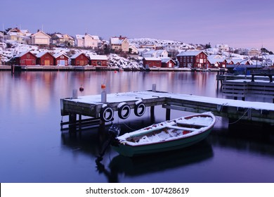 A boat and a jetty in the winter, Sweden.