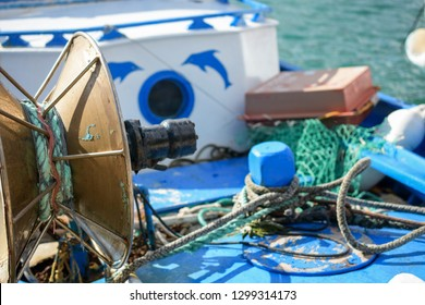 Boat in Kalymnos Island with some of the fisherman's equipment