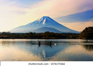 Boat kayaking at Shoji lake with mount Fuji view with twilight sky at dawn, Yamanashi, Japan. Water sport and outdoor recreation exercise activity with beautiful scenics view.