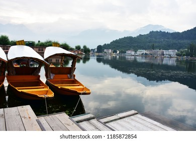 The boat in the lake with crystal clear water is a popular attraction of Kashmir.