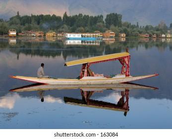Boat in lake. Kashmir