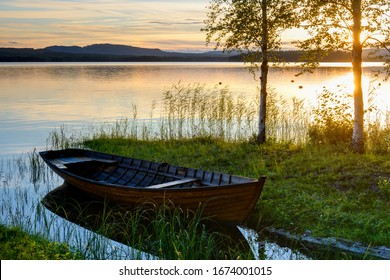 Boat at the lakeside at sunset, Sweden