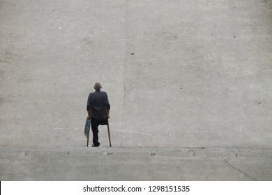 BOAT LANDING AT YANGTZE RIVER/CHINA - June 2018: disabled man with crutches alone going down the stairs