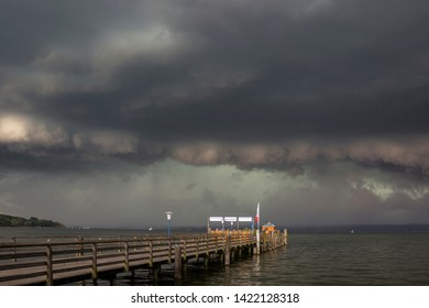 Boat launch on the Ammersee in Bavaria in front of a sky with thunderstorm atmosphere German Text Southern tour, no entrance, northern tour