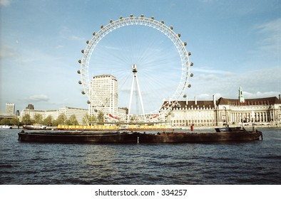 boat and London Eye on Thames River in London