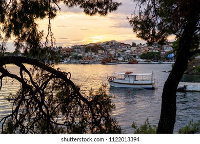 Boat in Mediterranean harbor during sunset