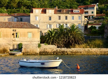 Boat & Mediterranean Houses at Sunset - Vis, Croatia