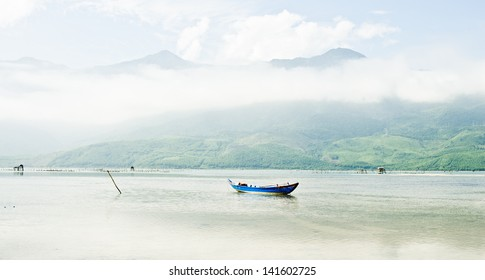 A boat in the middle on a large lake