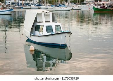 Boat in Mikrolimano Harbour, Piraeus, near Athens, Greece.
