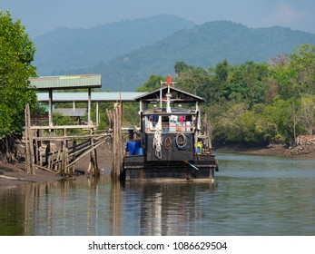 Boat moored at a canal cutting through the mangrove forest on Kadan Kyun, previously King Island, the biggest island of the Myeik Archipelago, in the Tanintharyi Region of Myanmar.