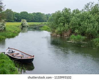Boat moored on the bank of a river