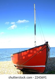 A boat moored on the beach in England