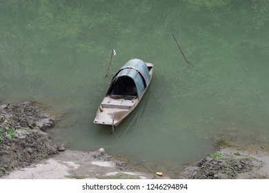 Boat moored on the river