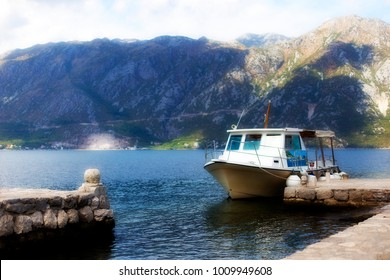 the boat moored to the shore, the sea and the mountains, Montenegro