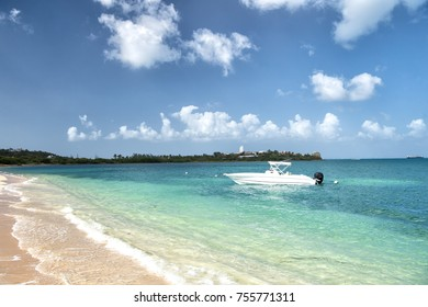Boat or motorboat on sea or ocean water in Philipsburg, St Maarten at tropical beach on sunny day on blue seascape. Summer vacation, travelling, wanderlust concept