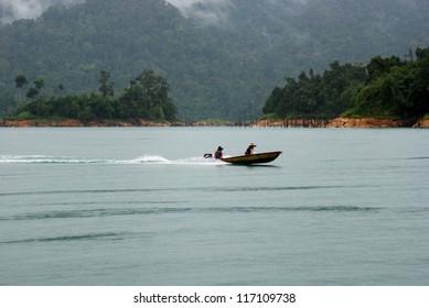 Boat moving a cross a lake