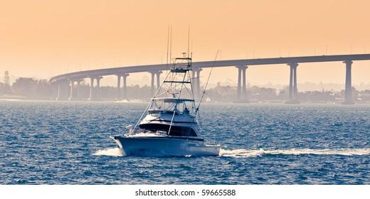 Boat near the San Diego - Coronado Bridge, locally referred to as the Coronado Bridge crossing over San Diego Bay in the United States, linking San Diego, with Coronado, California.