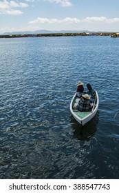 Boat near the Uros Islands on Lake Titicaca, Peru