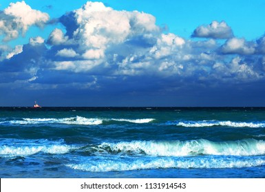 boat in the ocean amid a thundercloud