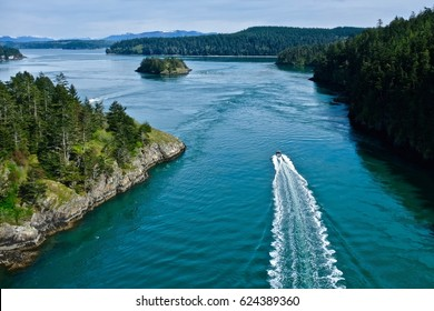 Boat in the ocean among islands. Deception Pass State Park. Puget Sound.  WA. United States.