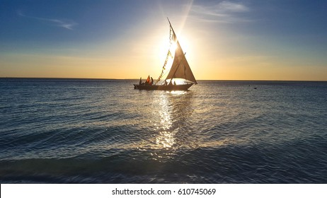 Boat in ocean at sunset, Zanzibar