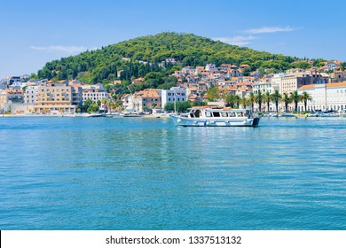 Boat at Old city of Split on Adriatic Coast in Dalmatia in Croatia. Ship at Diocletian Palace and Roman Town architecture at Croatian Dalmatian Bay. Europe tourism and vacation in summer.