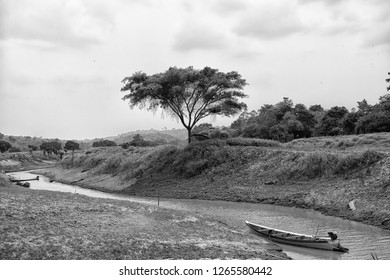 Boat on amazon river in boca de valeria, brazil. Amazon river flow on tropical landscape on cloudy sky of brazil. Brazil nature and wild life. Water transport and travelling on Amazon river in brazil.