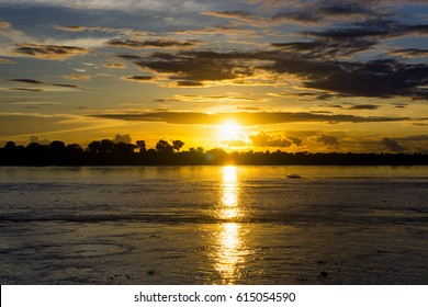 Boat on the Amazon River at sunset near Leticia, Colombia