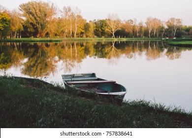 Boat on autumn lake