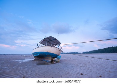 boat on the beach at sunset time.