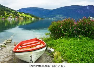 Boat on the beach of village Olden in Norwegian fjords.