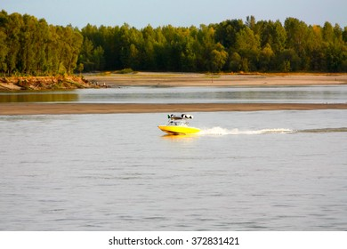 Boat on the big river. Autumn walk along the river in a motor boat.