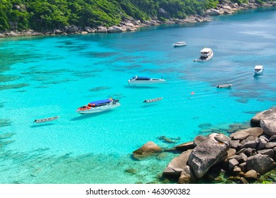 Boat on Blue Ocean and Clear Water  with Blue Sky at Island Thailand