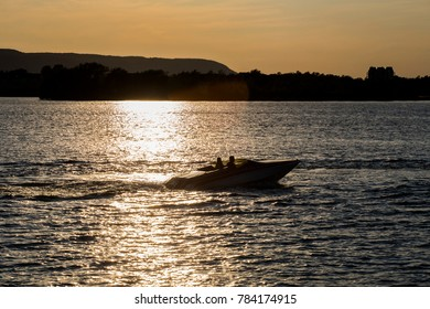 boat on the calm water near sunset