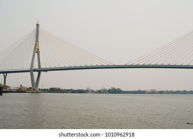 Boat on the Chao Phraya River And the bridge to Thailand.