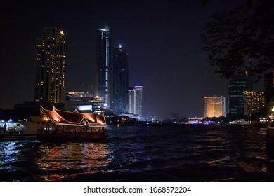 Boat on Chao Phraya River at Night in Bangkok, Thailand