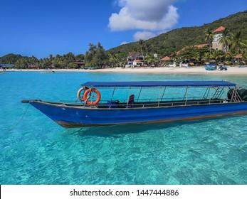 Boat on clear water near Redang Island, Terengganu, Malaysia