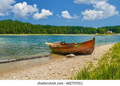 Boat on the coast of Black Lake (Crno jezero) in Durmitor National Park, Montenegro