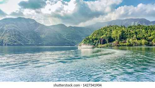 Boat on Como lake in Italy - Tourism on Como lake - Image