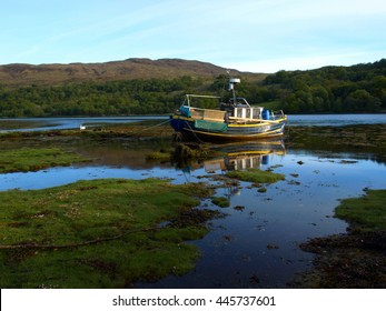 Boat on the corner of Loch Linnhe and Loch Eil near Ben Nevis, Scotland - Reflections on Water