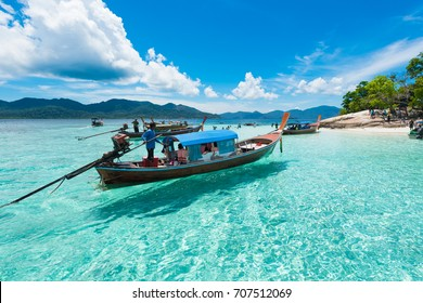 the boat on the crystal clear water in andaman sea Thailand