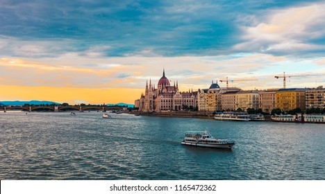 Boat on the Danube river, Hungarian Parliament Building sunset in Budapest
