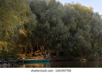 Boat on Danube river at sunset