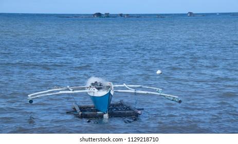 Boat on a float at Plaridel, Mindanao island the Philipines